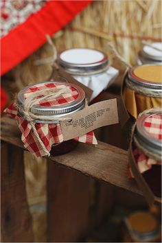 jam wedding favors. Our wedding :) Jam homemade by a local company Top of the HIll Jams in Kingsburg, CA. I bought fabric, cut into squares, typed up a quote and tied on with twine. Photography by Kimberly Carlson