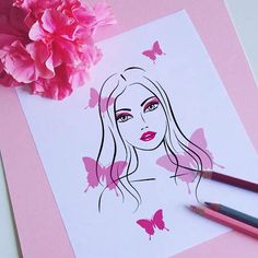 On my desk: pink #lady with butterflies #illustration (available in my #Etsy shop)