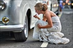 If she would just stand and take the pic over, we could see the fab looking car. It's silver, vintage, what is it.......