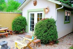 Outside this shed looks more like a tiny house than a backyard getaway, thanks to the French doors, lantern, and patio seating. Garden Gazebo, Backyard Sheds, Outdoor Sheds, Garden Sheds, Backyard Storage, Backyard Studio, Outdoor Spaces, Outdoor Living, Lofts