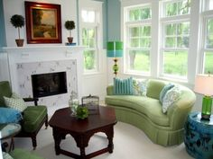 This is a happy room, like the kidney shaped sofa and adore the Stray Dog Lamp. Love green and blue! Crisp and happy!
