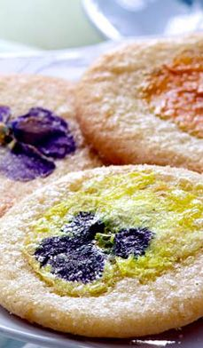 Pansy Flower Cookies from chef Martha Phelps use real pansies — yes, they're edible — and sugar cookie dough! Pretty and perfect to celebrate spring's April showers and May flowers! #recipes #desserts