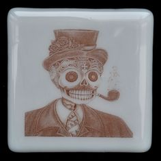 Fused Glass Coaster - Dia De Muertos 07 – Day Of The Dead – £7 each or £24 for a set of 4. Original drawings by Jiewsurreal (stock photos). All coasters measure approximately 10 x 10cm, with clear rubber bumpers on the base to keep them in place and protect your furniture. www.glassbygenea.co.uk #glassbygenea #fusedglass