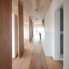 The floors and ceilings are covered in the same boards in this tiny Tokyo apartment renovated by Japanese architects TANK