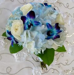 blue orchids and hydrangea with white roses