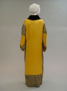 Opera coat Designer: Paul Poiret (French, Paris 1879–1944 Paris) Date: 1912 Culture: French Medium: silk, metal Dimensions: Length at CB: 16 1/2 in. (41.9 cm)