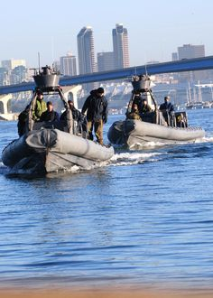 "Special Warfare Combatant-craft Crewmen (SWCC) instructors prepare to dock two 11-meter rigid-hull inflatable boats at Naval Amphibious Base Coronado after dropping off Basic Crewman Training Candidates into San Diego Bay.  BCT candidates are in a training evolution known as the ""Tour"" -- a 3day, 2night training session that is the final stage of the 7week BCT program testing the students physically+mentally on what they've learned, and is the final phase of SWCC training."
