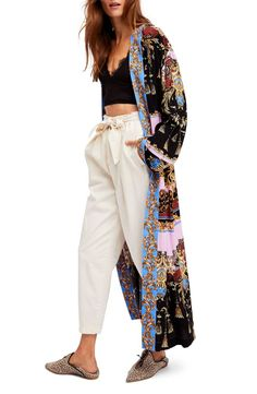 If the ornate print doesn't get you noticed, the dramatic fluttering length of this extra-long silky topper most definitely will.