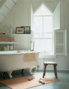 love the pointed window. bathrooms need windows, especially when there's a claw-foot tub involved.