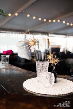 DIY centerpiece. Mid-century modern. White, black, gold. Atomic stars. Harbor Cruise wedding reception. Casablanca Cruises. Portland, Maine.