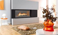 modern screen electric fireplace design in living room with brown fur rug on hardwood flooring includingflower vase the top white round table as well lamp desk beside fireplace