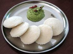 Idli: What It Is: A heavy South Indian breakfast food. A fermented batter of ground rice and lentils, steamed in little circular moulds. Perfect For: When you're done sleeping in on a Saturday morning. Feels Like: Being woken up by the smell of cooking Indian Breakfast, Breakfast Dishes, Breakfast Recipes, Traditional Indian Food, Comida India, Idli Recipe, Desi Food, India Food, Savory Snacks