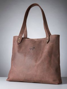 Handbag is handmade from high quality Lithuanian leather. There is a possibility to order different colours depending on what kind of leather we have on