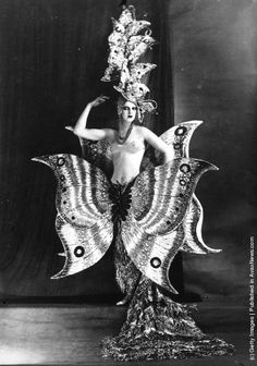 A cabaret dancer wearing a fantastic butterfly costume at the Folies Bergere theater, Paris. Circa 1910