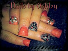 Coral leopard and silver gel nails with large and small rhinestone design