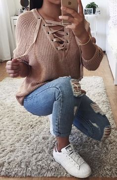 #winter #outfits brown laced-neck sweater and distressed blue-washed denim jeans outfit