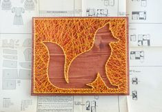 Fox silhouette made from colorful strings. It will be a perfect match to your kids room or nursery and actually decoration will fit any room where you want to add a bit more decoration. Only high quality materials are used in the preparation of this string art. Wood base is made from solid wood plank, colored and waxed to give rustic and special touch to it.