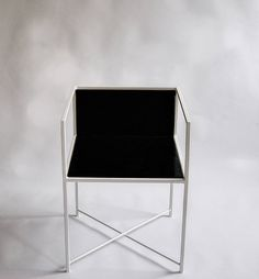 Gentle steel silhouette painted in white and contrast coloured wooden seat.