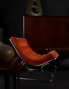 Dark living room, vintage orange lounge chair