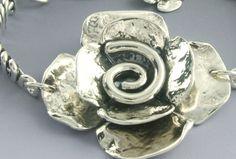 "Artisans Nest - Sherry Tinsman sterling silver 1 3/4"" Double Dogwood and Spiral Bracelet, $286.00 (http://store.artisansnest.com/sherry-tinsman-sterling-silver-1-3-4-double-dogwood-and-spiral-bracelet/)"