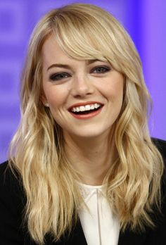 The Best Hairstyles with Bangs - Emma's side-swept bangs are good for a round face