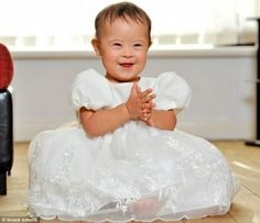 Little girl with Down syndrome is the 'darling' of the child modeling world in the UK - may Taya's beautiful smile soften the hearts of those who think children with Down syndrome should never be born!