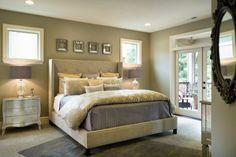 beige master bedroom with upholstered bed