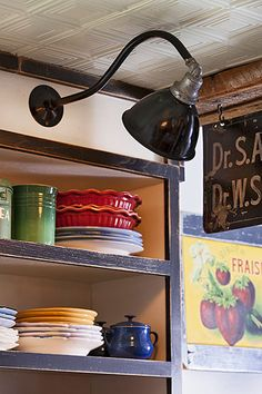 Colorful vintage dishware deserves to be displayed on open shelves. This one even has a spotlight!