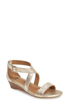 Free shipping and returns on Söfft 'Innis' Low Wedge Sandal (Women) at Nordstrom.com. Extra cushioning under the ball and heel of your foot feels wonderful in a breezy sandal with crisscrossed straps and a low, walkable wedge. A perforated leather footbed furthers the comfortable breathability of this summer style.