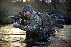 The Corps of Royal Marines (RM) is the United Kingdom's amphibious light infantry force, forming part of the Naval Service, along with the Royal Navy. British Royal Marines, British Armed Forces, British Army, Military Love, Military Guns, Marines Logo, Army Video, War Photography, Army & Navy