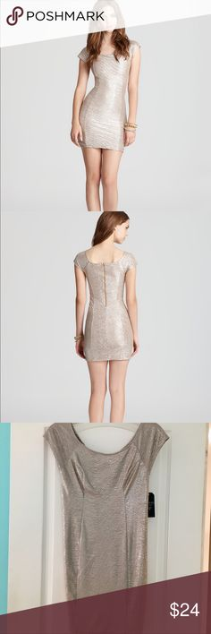 GUESS Shimmer Jacquard Khloe Dress (BRAND NEW) PRODUCT DETAILS Beautifully woven from shimmery metallic jacquard, this body-con GUESS dress flaunts your curves for a party-perfect look that lights up any room.  Boat neck, cap sleeves, form fitting Metallic shimmer, exposed back zip Polyester Hand wash Guess Dresses Midi