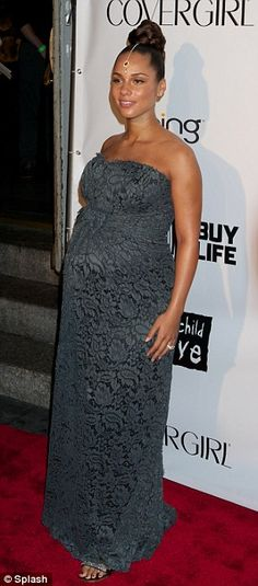 Beautiful: Pregnant Alicia Keys looked gorgeous and in love on the red carpet at the Keep A Child Alive Black Ball with new husband Swizz Beatz