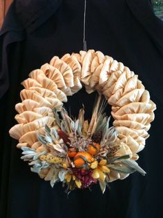 Autumn Corn Husk wreath with corn husk flowers & pumpkins, mini corn, wheat, lambs ear and dried flowers. The base is a straw wreath form. This can be hung outdoors in a covered area and boxed and stored dried until hung again year after year. Corn Husk Wreath, Straw Wreath, Thanksgiving Crafts, Fall Crafts, Christmas Crafts, Autumn Wreaths, Holiday Wreaths, Corn Husk Crafts, Corn Husk Dolls