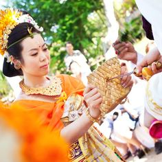 The bride performs Balinese wedding ritualsReal Weddings - Bali Beach Wedding