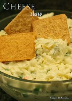 This dip is sooooo good and super easy.    Cheese Slaw 1 pound Swiss cheese, shredded 1 bunch green onions, chopped 1/2 cup mild banana peppers, finely chopped 1/4 cup pickled jalapeno peppers, finely chopped Mayonnaise - enough to bind Mix it all together and place it in a bowl.  Serve with crackers or corn chips....I like large Wheat Thins.