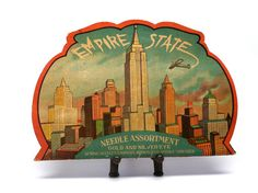 Decorated with striking graphics of 1930s-40s architecture nice vintage needle book.    The Empire State needle book is in nice condition. Some
