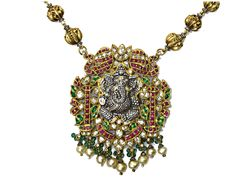 Lord Ganesh pendant studded with diamonds, rubies, emeralds and pearls, from Karni Jewellers.