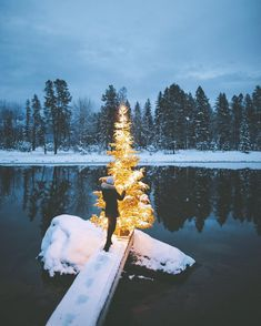 Andrea putting the finishing touches on the Swan River Xmas Tree. Merry Christmas from Montana..! by alexstrohl
