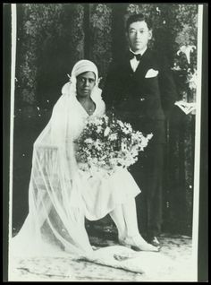 Asian & Black Couples — A photo of a Japanese man marrying a Black...