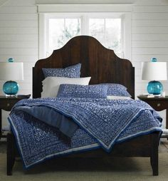 My wife was right. I WOULD love this dark wood board headboard. Also like the wood plank white wash walls and blue accents.