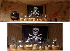 Fun decorations for a Pirate theme.  The jars are filled with sand, seashells, and wooden letters painted black.