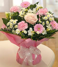 sent soft pink and ivory aquapack flowers delivere