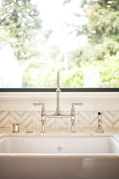 Designer Lindsay Chambers added a Rohl bridge faucet to complement this industrial-country kitchen. The polished nickel finish adds an elegant touch. Beadboard Backsplash, Herringbone Backsplash, Kitchen Backsplash, Backsplash Ideas, Rustic Backsplash, Granite Backsplash, Dark Countertops, Mirror Backsplash, Herringbone Pattern