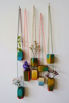 How wonderful do these hanging planters planters look? Hung on different coloured strings to make a living wall of tiny plants it has the effect of bringing nature indoors - albeit in a small way.thebestlittleapartment: hanging planters via AFNOLET. Turbulence Deco, Best Decor, Hanging Planters, Diy Hanging, Wall Planters, Succulent Planters, Clay Planter, Hanging Herbs, Hanging Succulents