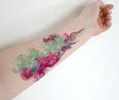 An amazing smoke tattoo