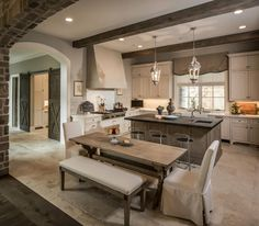 pretty kitchen....travertine floors, marble counters, slate island, great lanterns, stainless appliances....pretty much me...