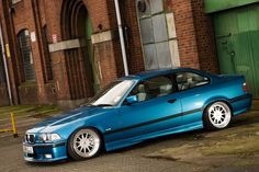 Splendorous Atlantisblau BMW e36 coupe on cult classic OZ Hartge design C wheels