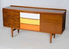 A teak and multicolored laminated veneer sideboard made by Welters of Wycombe. In excellent condition with curved front and bespoke laminated drawer fronts.  https://www.1stdibs.com/furniture/storage-case-pieces/sideboards/british-late-1960s-sideboard/id-f_1351073/