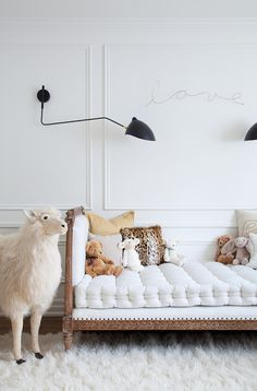Source: Bijou & Boheme I've spent the last week working on kids room designs and this image is strangely appropriate and on cue with its beaded panelling, Serge Mouille wall lights & neon sign. Rather...