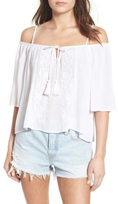 Dainty flowers embellish the front of a breezy cold-shoulder woven top cut in a relaxed fit and finished with adjustable straps for $30. Band of Gypsies Embroidered Cold Shoulder Top